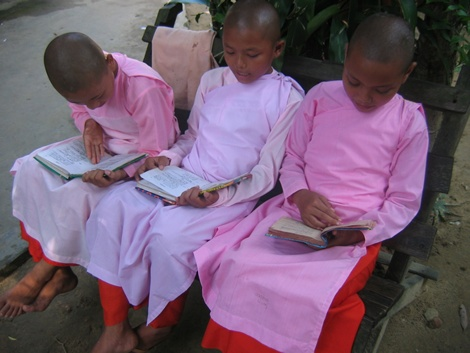 3 nuns studying outside